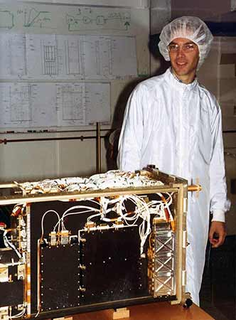 Ørsted satellite in assembly; the gold plated turnstile antenna is mounted in top corner.